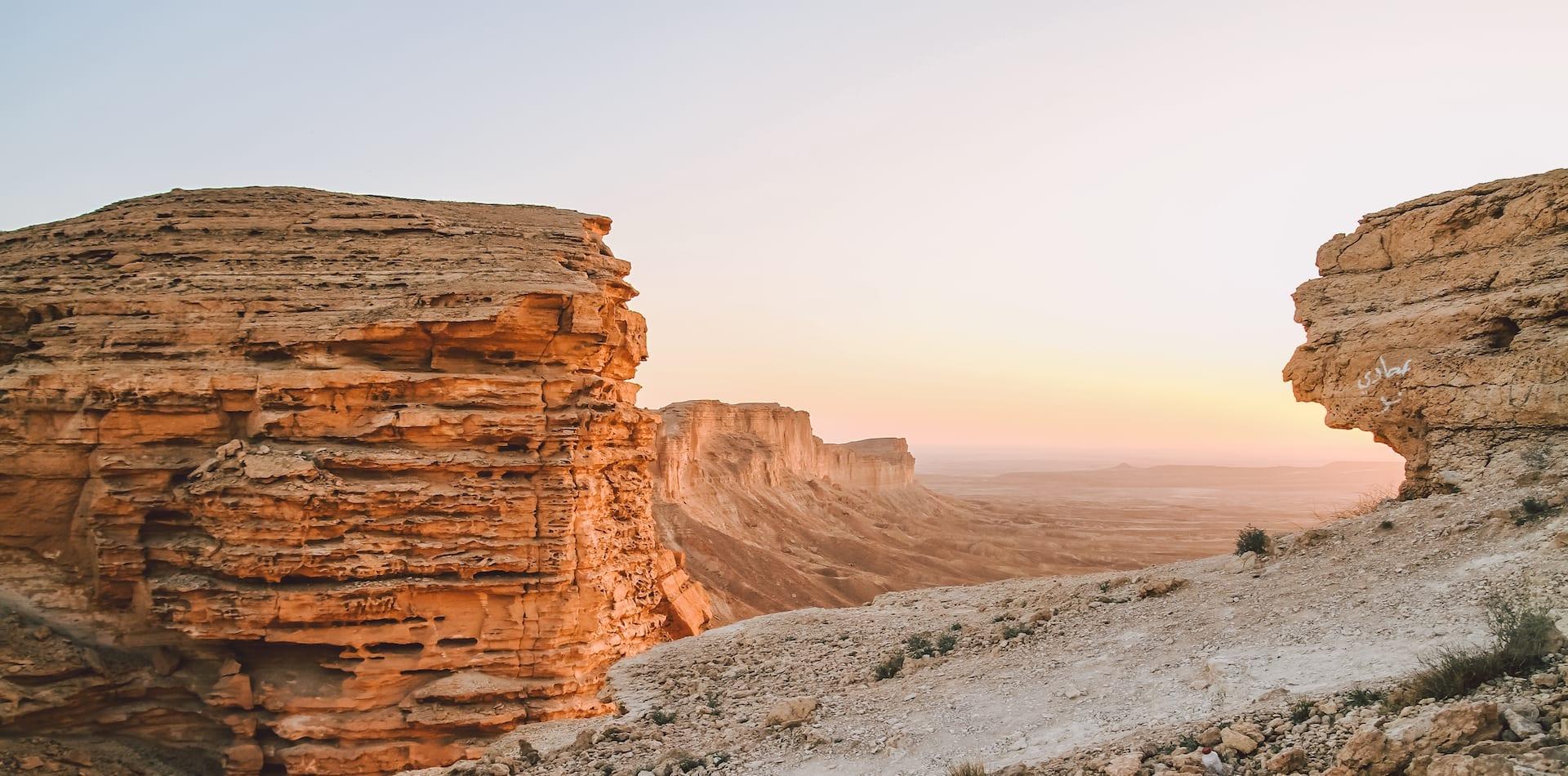 sunset falls upon Saudi's intricate rock formations