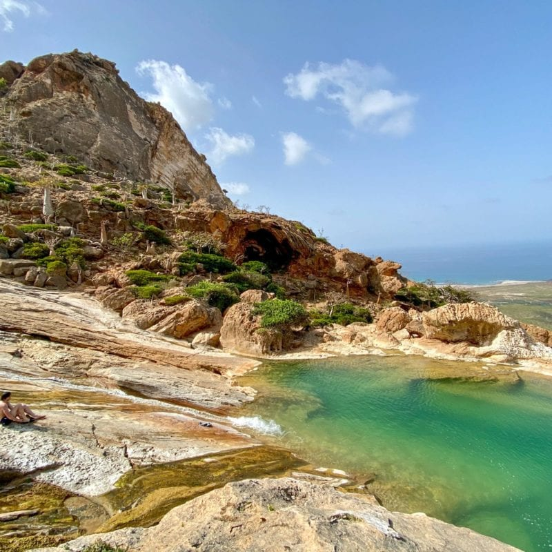 a natural fresh water pool formed in the rock