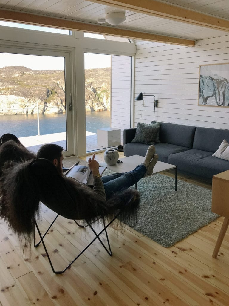 Relaxing inside Ilimanaq Lodge with view of ocean