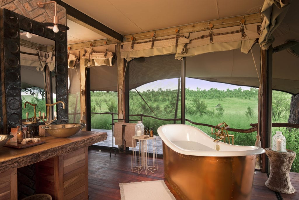 Bathroom with African Bush Views at Somalisa Camp in Zimbabwe