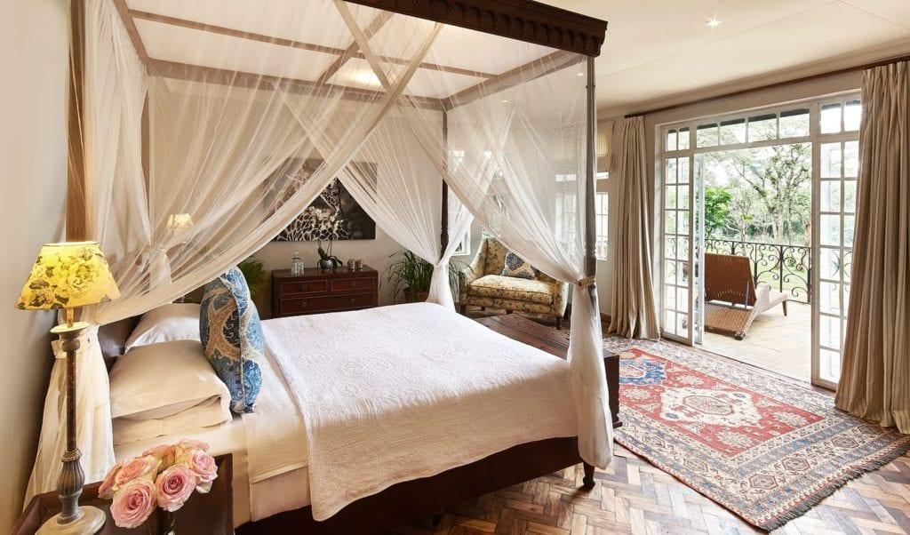 Bedroom Interior with Balcony at Giraffe Manor Kenya