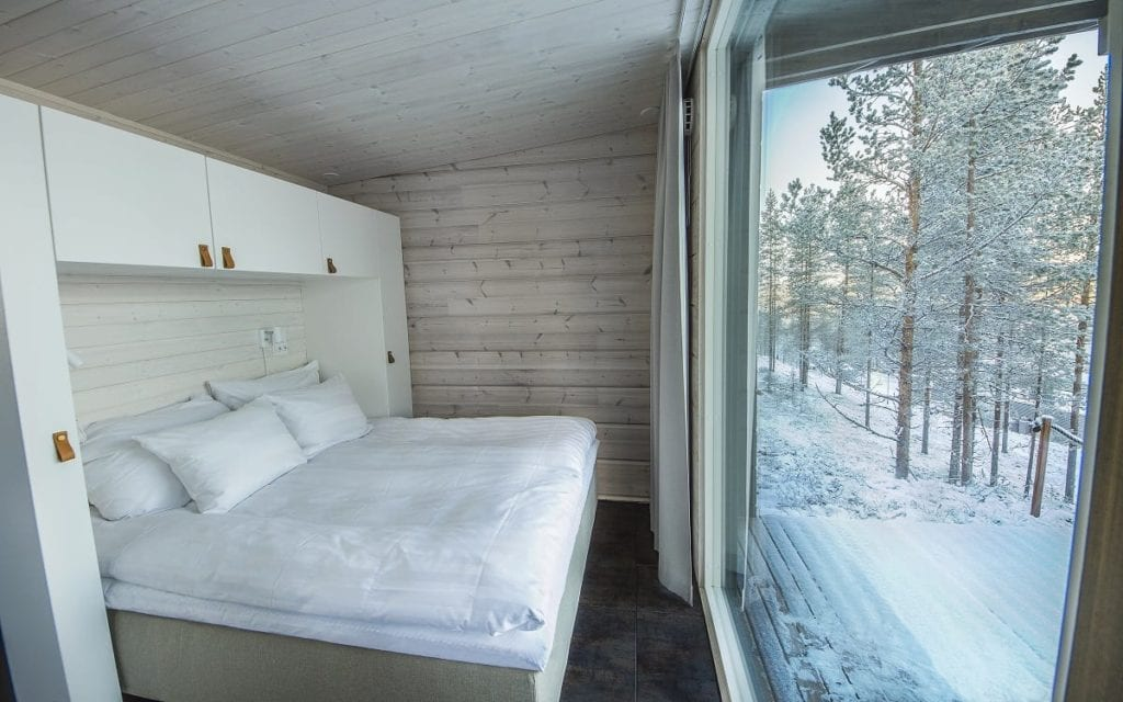 Bedroom with Ecternal Forest Winter Views at ARctic Treehouse Finland