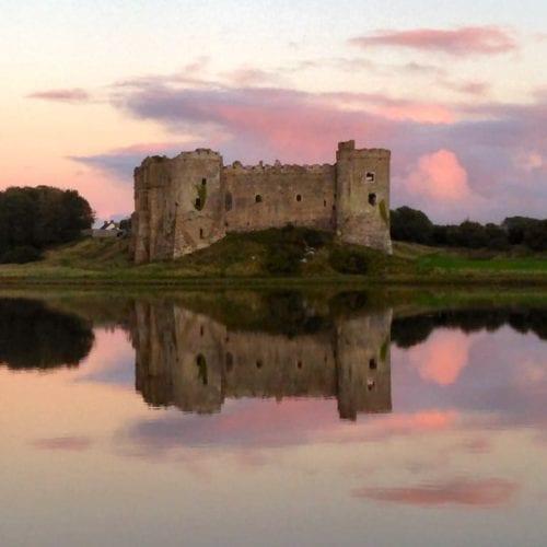 Carew Castle at Sunset Pembrokeshire Wales UK