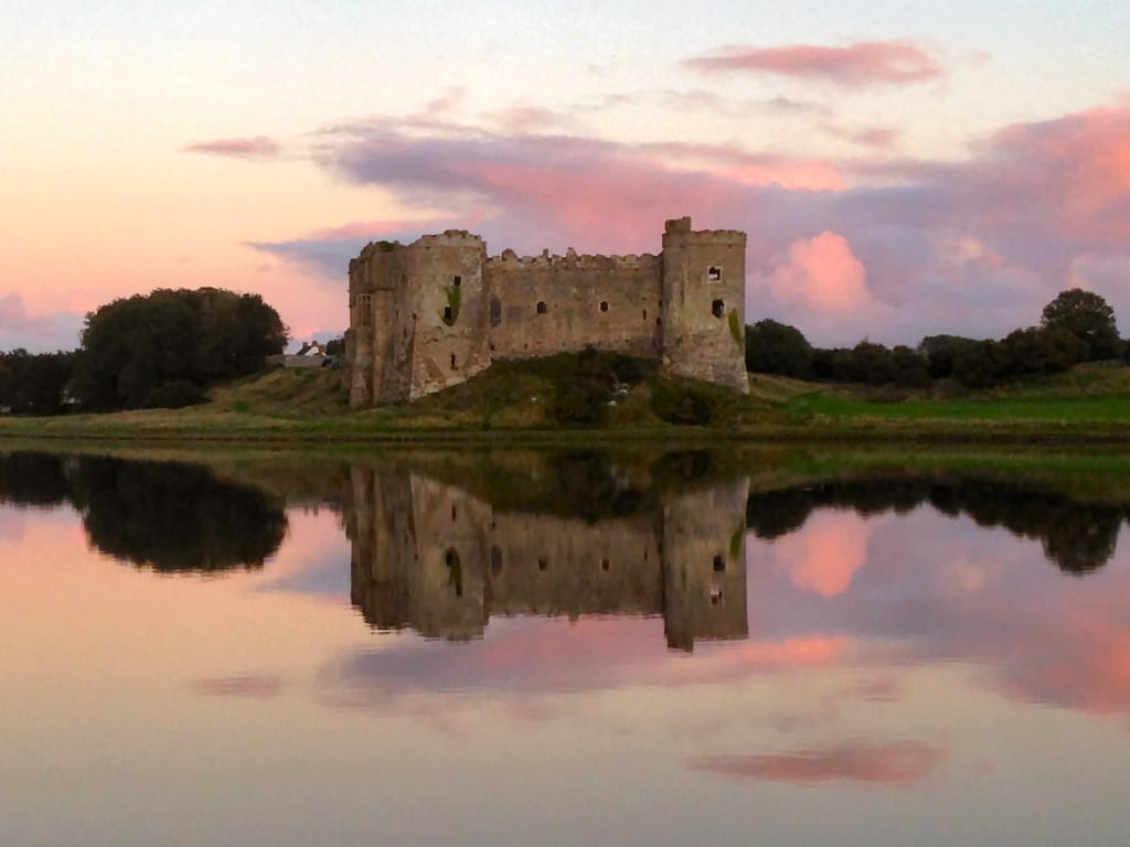 Carew Castle at Sunset Pembrokeshire Wales UK