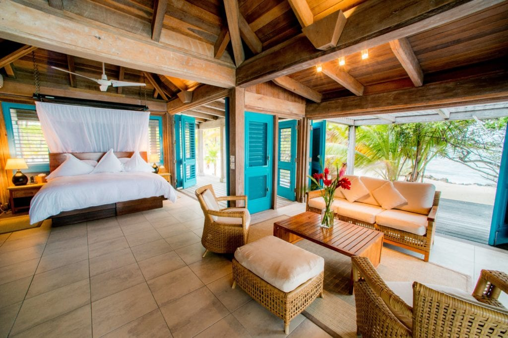 Casa Brisa Interior Bedroom and Seating Area at Cayo Espanto Belize
