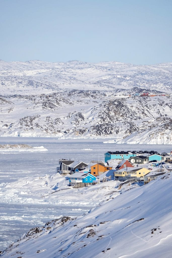 Following the blue hiking trail from the Icefjord for view of Ilulissat village Greenland