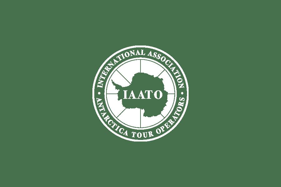 White logo of IAATO