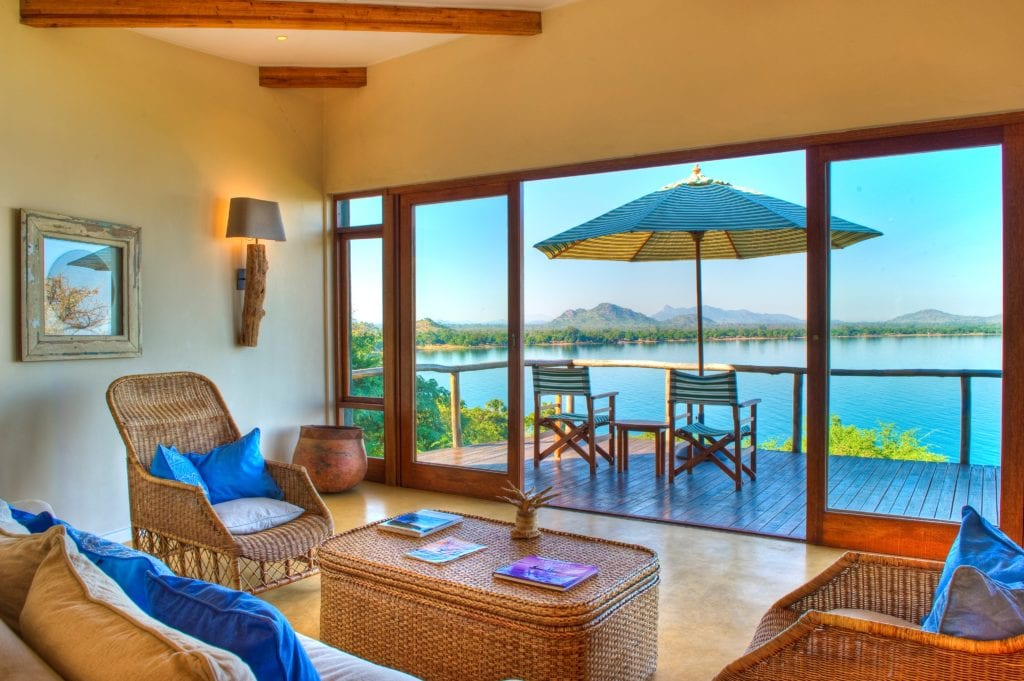 Interior of Lounge and Seating Area with View of Lake Malawi at Pumulani Africa