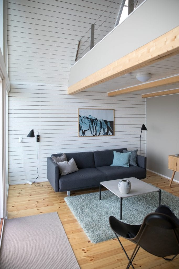 Living room at Ilimanaq Lodge with artwork and loft in Greenland