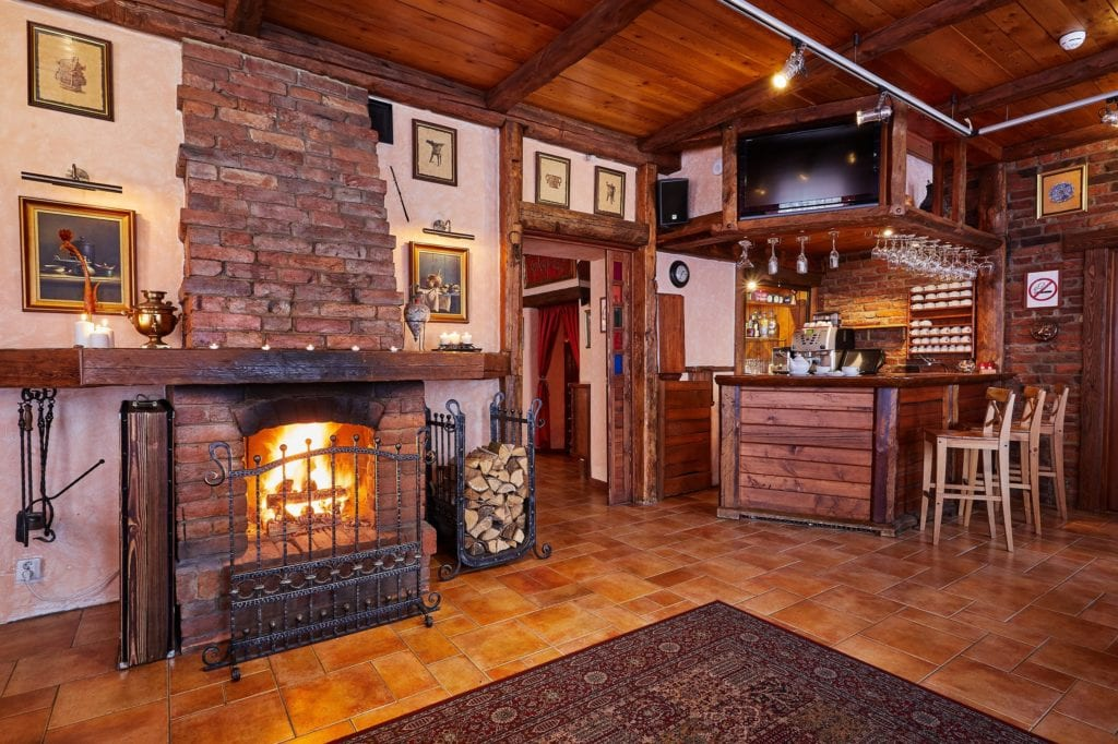 REstaurant and Bar Area with Fireplace Interior at Alexander House St Petersburg Russia