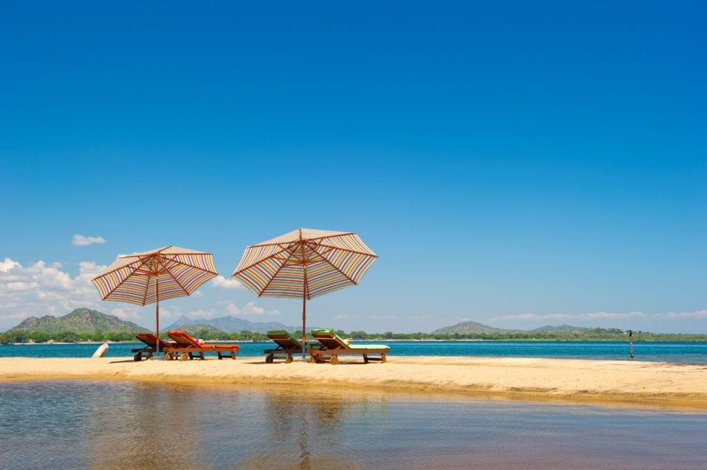 Sun Loungers on the Shroe of Lake Malawi from Pumulani Malawi Africa