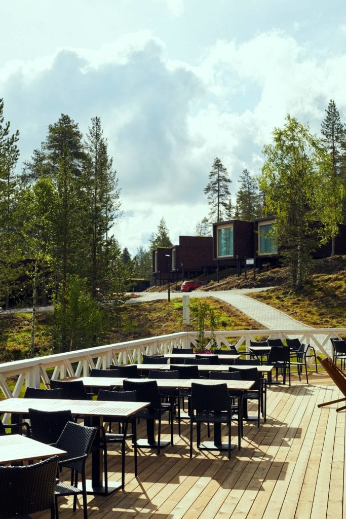 Terrace and Outdoor Lounge Seating Dining Area at Arctic Treehouse Finland