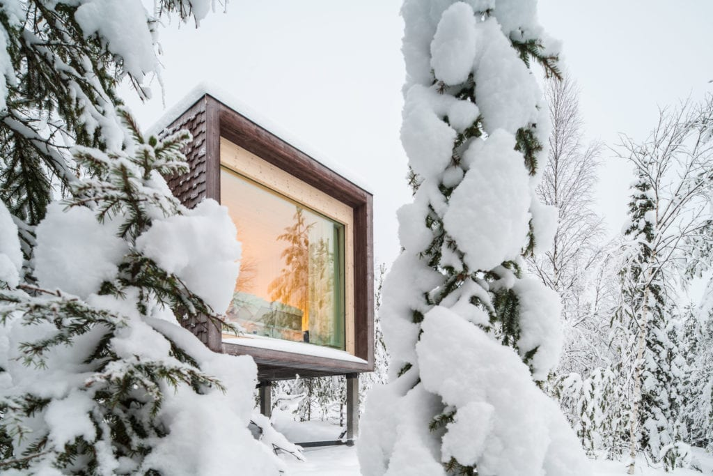 Exterior of Arctic Treehouse in Winter Snow Finland