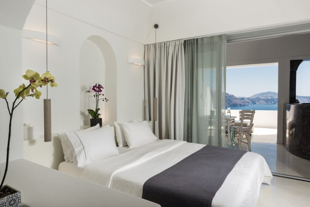Andronis Luxury Suites honeymoon suite bed and view