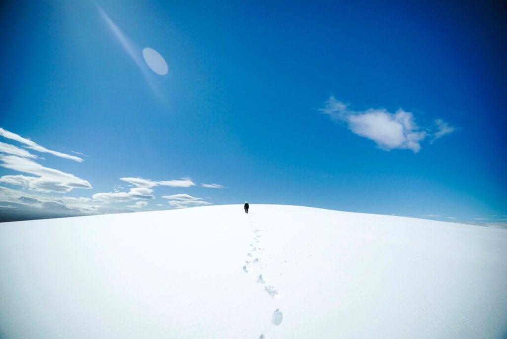 A Man Walking Through Snow in Antarctica