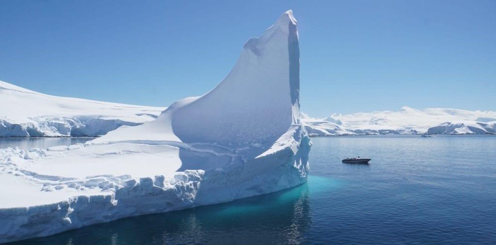 Yacht Tender next to an Iceberg in Antarctica