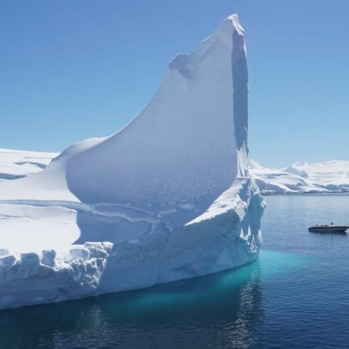 Yacht Tender next to an Iceberg in Antarctica
