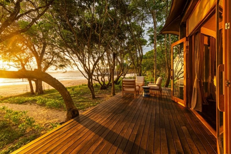 beach villa veranda boasts dreamy sunset views