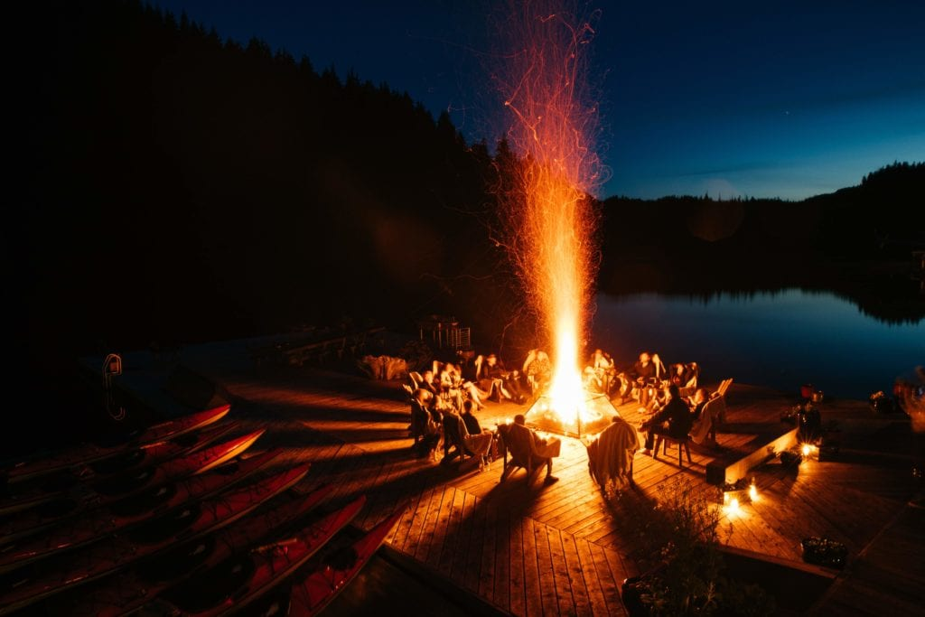 Relaxing around fire pit by night Nimmo Bay Canada