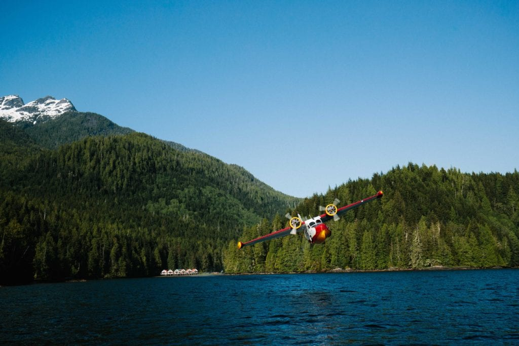 Plane flying across lake from Nimmo Bay Canada