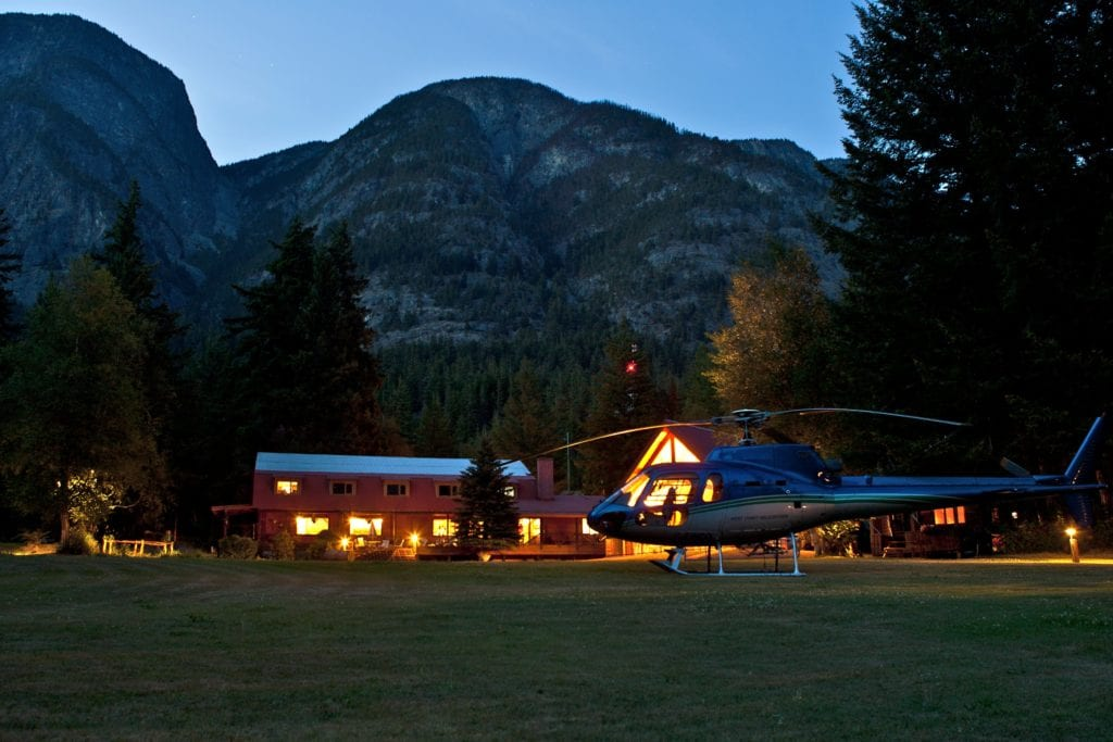 heli in front of Tweedsmuir Park Lodge Canada