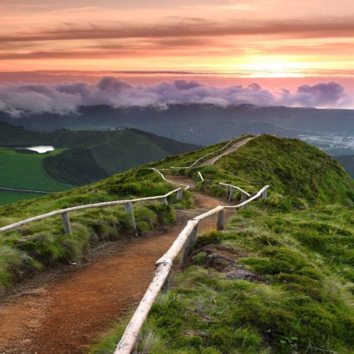 Hiking path along a ridge to the sunset