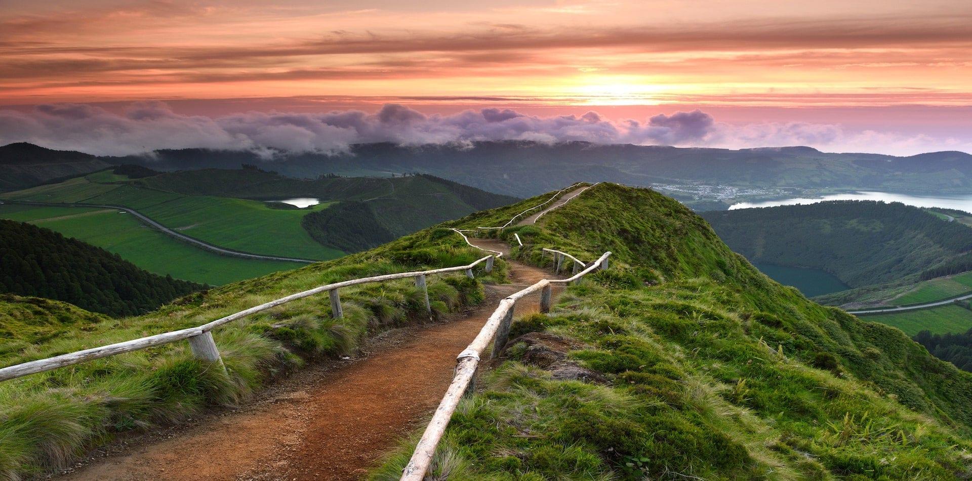 Hiking path along a ridge to the sunset
