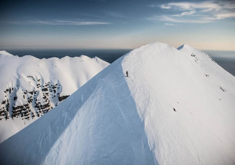 Ski from the top of peaks with views over the ocean