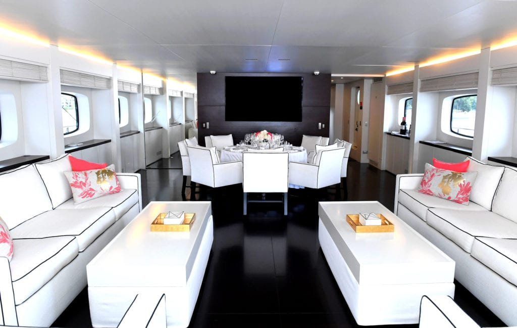 Seating and dining area on the Infinity Pacific