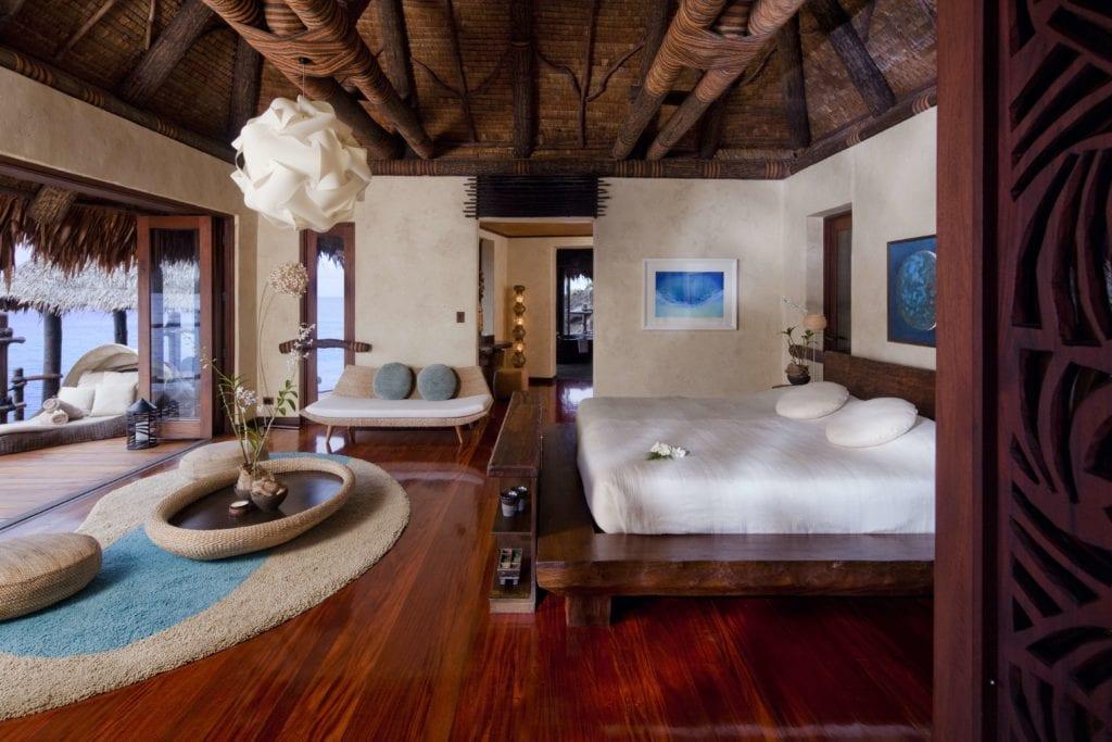 overwater villa bedroom laucala island