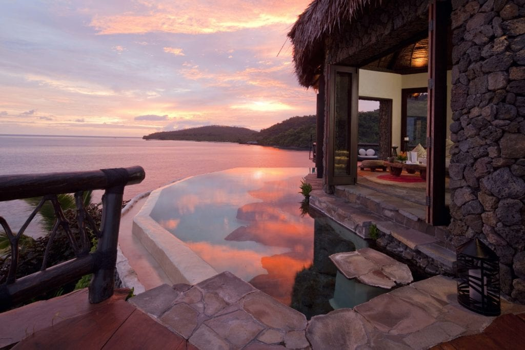 sunset over laucala island villa fiji