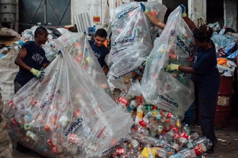 un-bagging the collection go hundreds to plastic bottles collected from the ocean