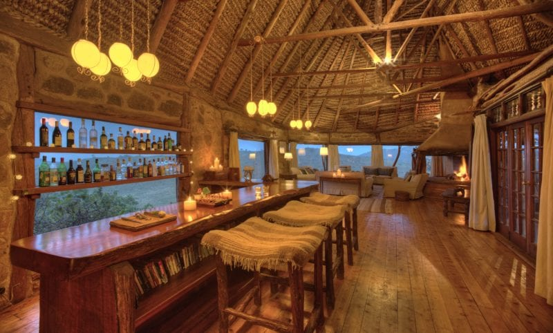 cozy chic reception area with bar and bar stools