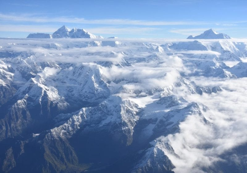 Snow-capped Himalayan mountains from above the clouds