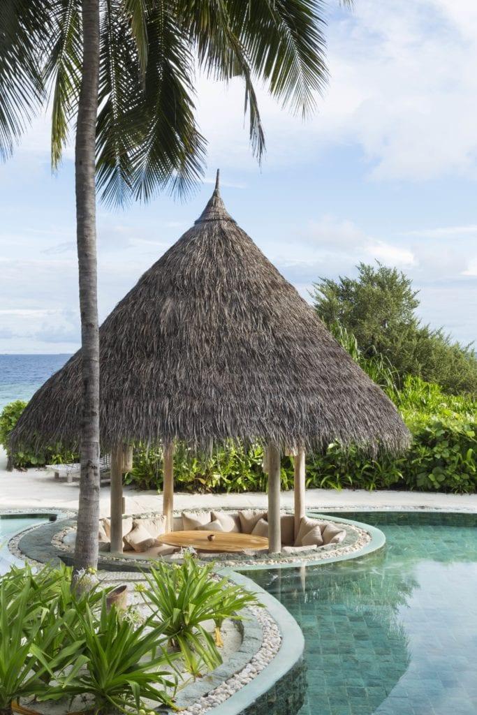soneva fushi thatch hut pool