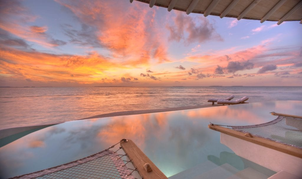 sunset ocean view soneva jani maldives