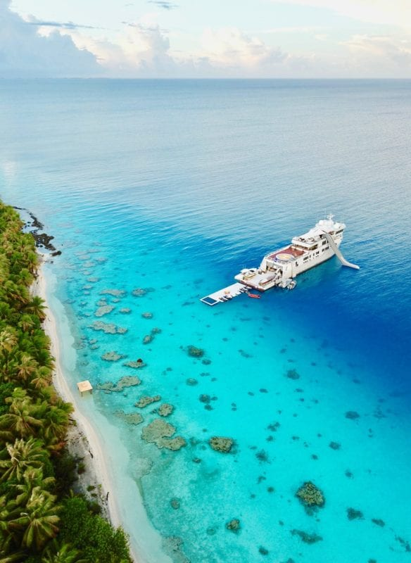 Aerial of Suri Yacht in Tropical Surroundings