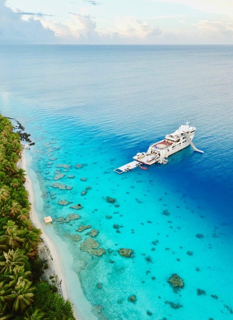 Aerial of Suri Yacht in Tropical Surroundings
