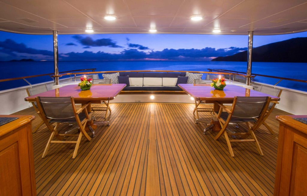 Covered exterior seating area on Teleost Yacht