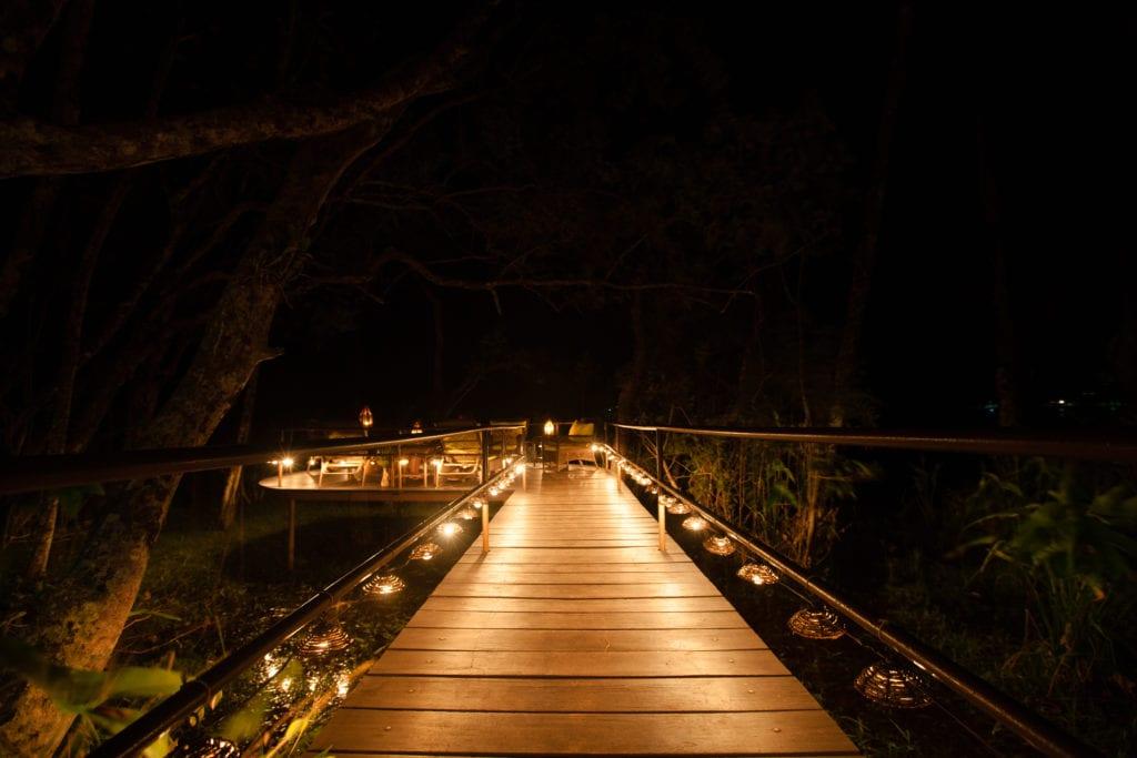 wooden walkway wakü lodge at night