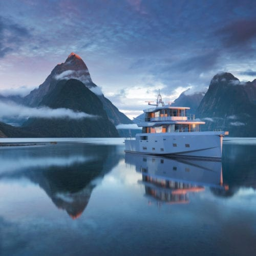 Arksen Yacht in front of mountains
