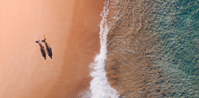 Surfers on an Australian beach