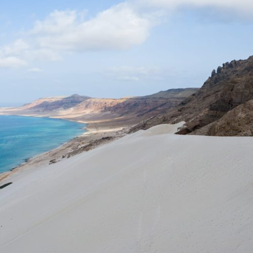 Sea meets towering dunes in Socotra