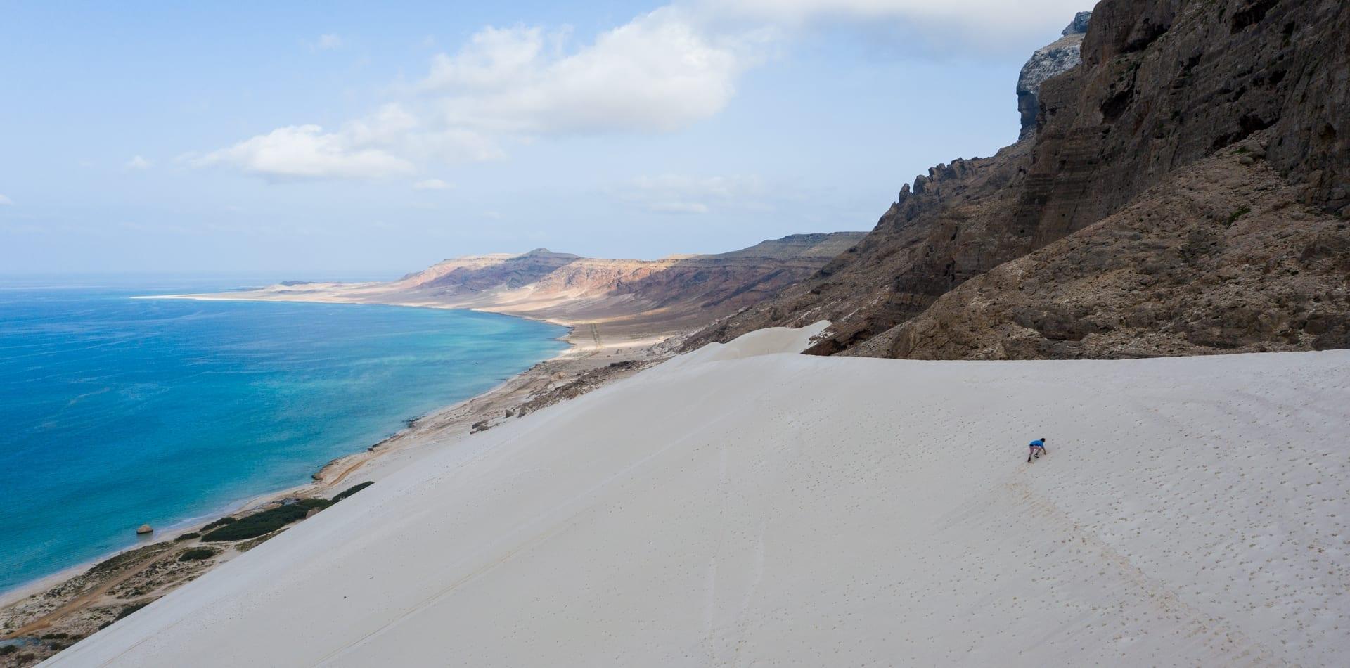Sea meets towering dunes in Socotra