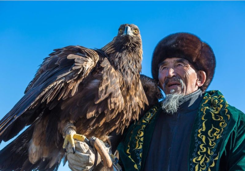 Local Kazakh man with an eagle