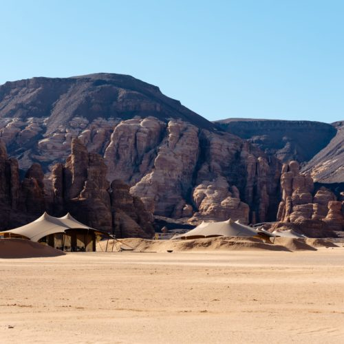 Luxury tented camps shaded by the mountains in AlUla, Saudi