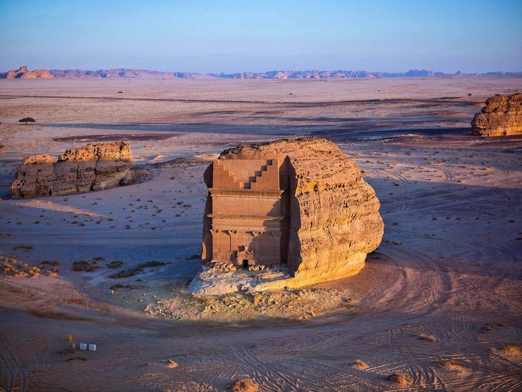 Mada'in Saleh ancient sandstone rock carvings at sunset