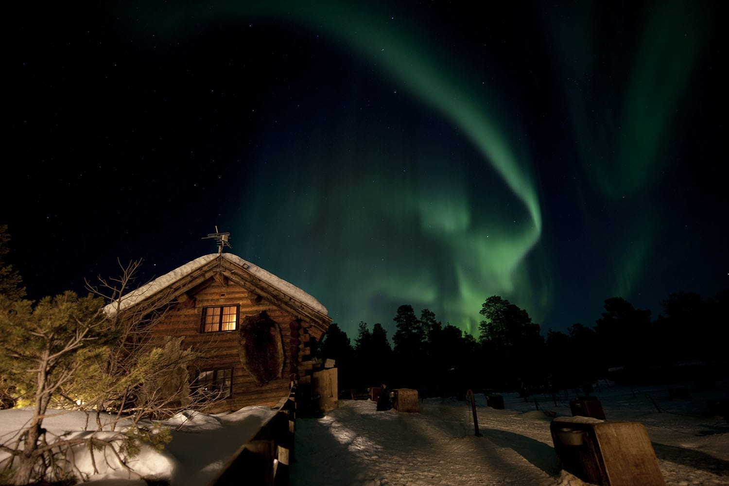 Northern Lights over a cabin in Norway