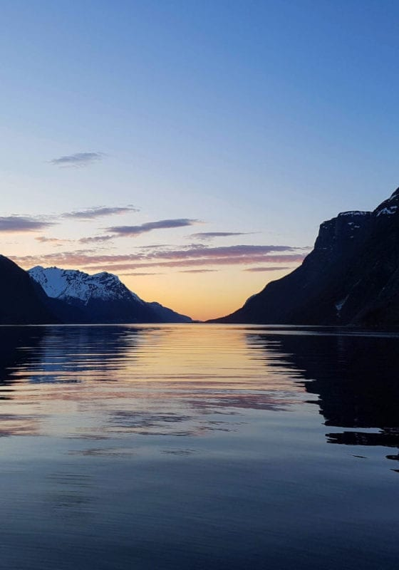 Sunset reflected on the waters of a Norwegian fjord