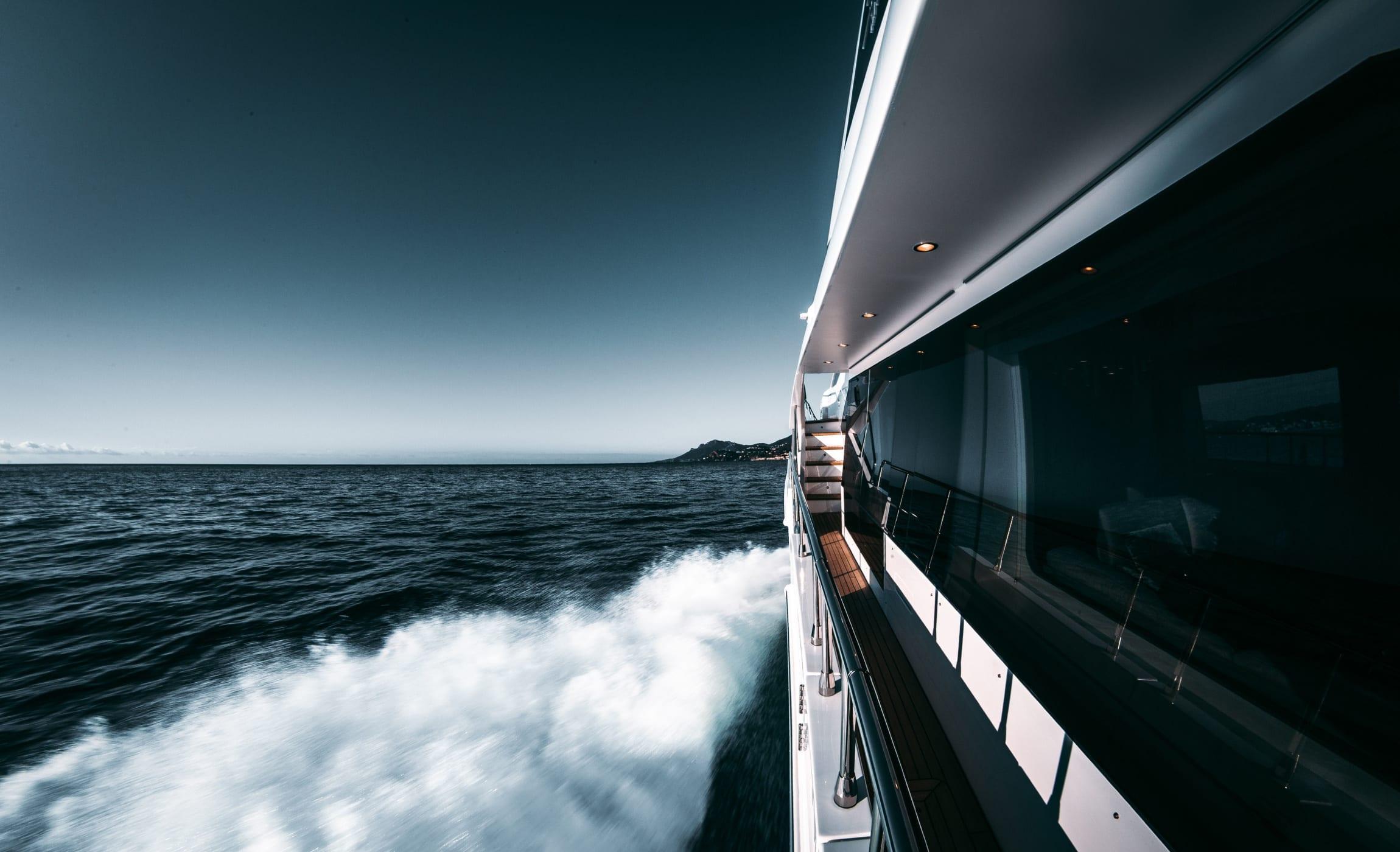 Luxury yacht running through open water